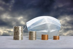 Stacks of coins in a decrease financial from COVID-19 crisis