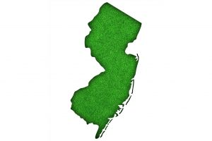 Map of New Jersey on green felt